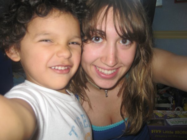Kayla on right as a teenager with a smiling toddler to her left
